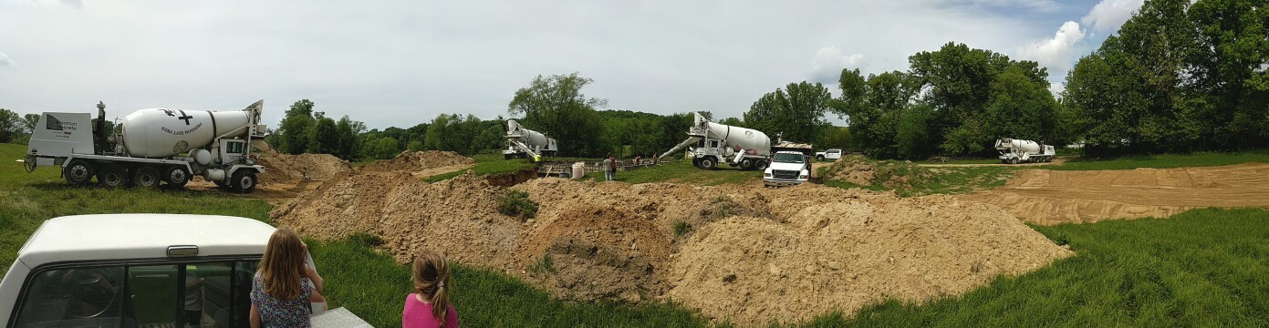 Concrete trucks pouring a new foundation.